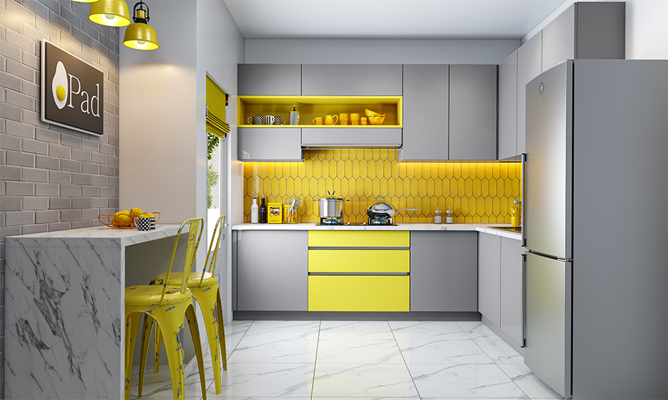Modern Indian kitchen interior designed with breakfast counter in Pantone colour of the year lends a chic look.