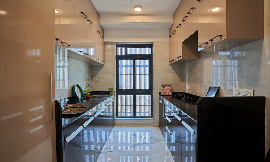 Parallel Indian kitchen interior idea for an apartment with loft cabinets look sleek and glossy.