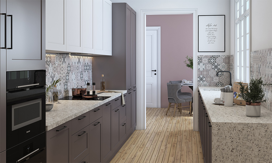 Simple Indian kitchen interior designed in a parallel layout with wooden cabinets and wooden flooring brings a natural feel.