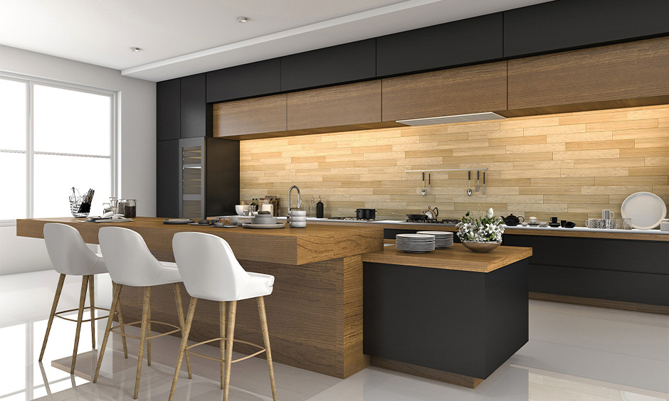Wooden interior for the kitchen of Indian style in white colour with breakfast counter looks minimal and clutter-free.