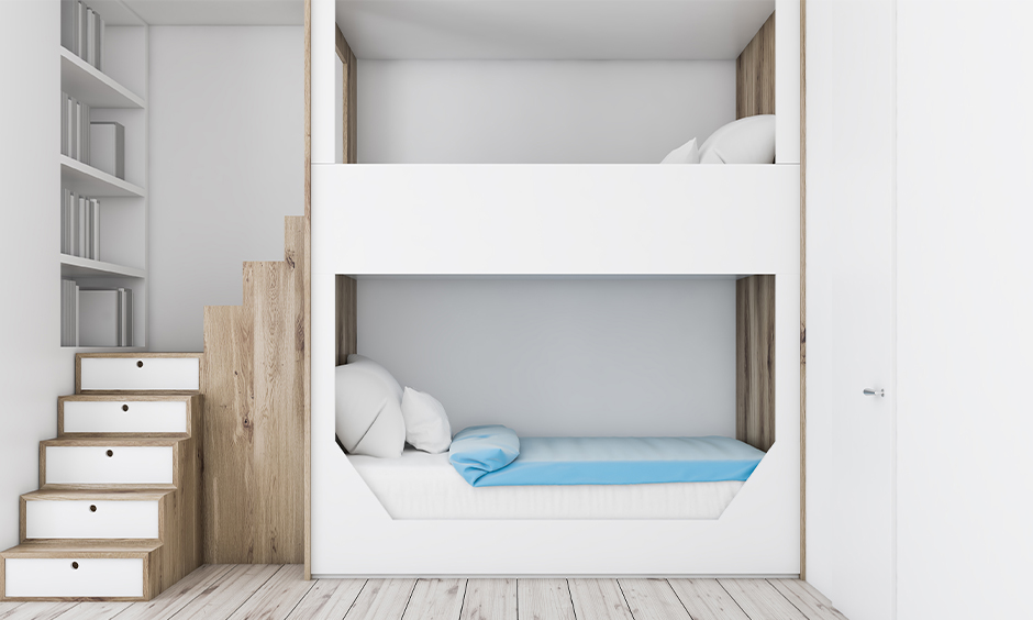 A double-decker space saving bunk bed for kids with stairs and hidden storage is the best space-saving design.