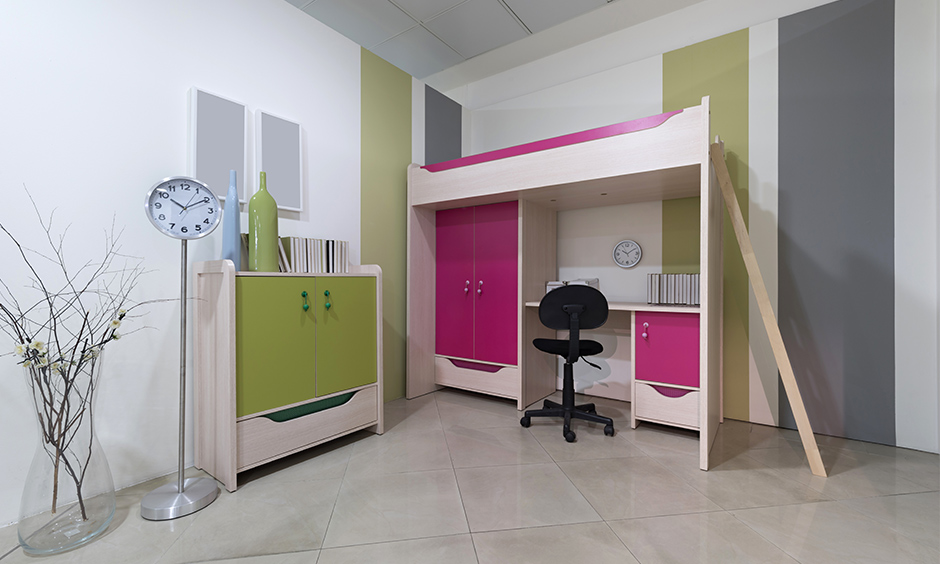 Space-saving kids bed with desk and cupboard combo made from light wood makes it look super cool.