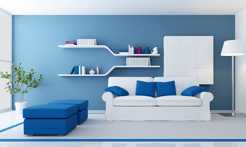 The living room has unique floating shelves that appeal to the interior and the best space-saving living room idea.