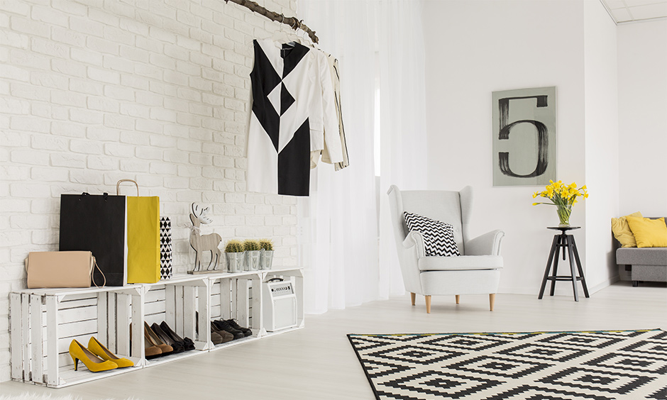 Space-saving living room idea, white living room with DIY shoe rack cum shelve adds a creative look to the place.