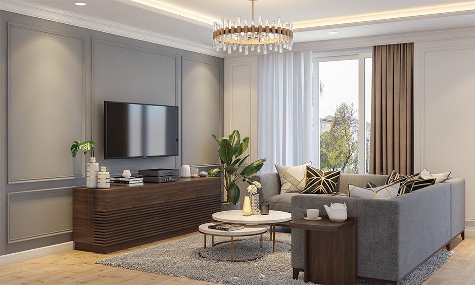 Space-saving living room with nesting coffee table saves space and makes a design statement with l-shaped grey sofa.