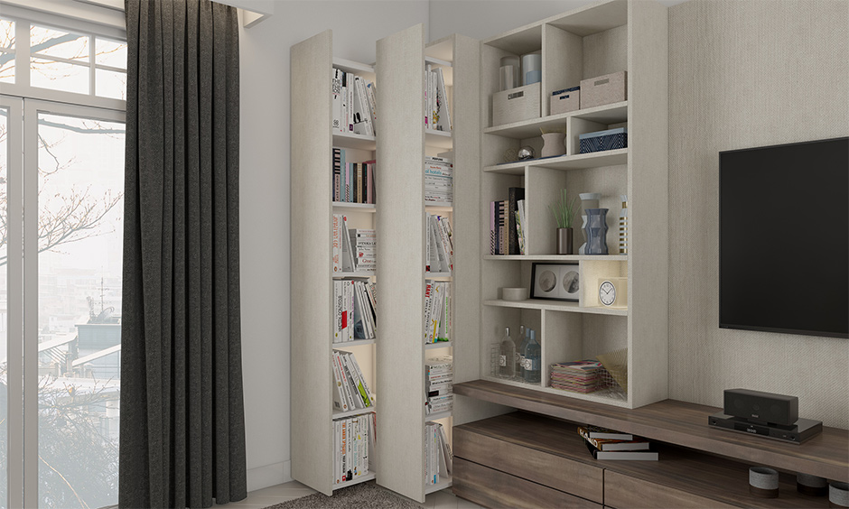 Space-saving living room furniture, the small living room has a bookshelf with hidden compartments attached to the tv unit.