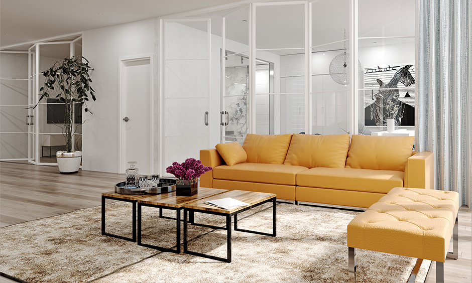 Space-saving living room idea, bi-folding glass partitions between rooms bring an airy vibe and appeal to the interiors.