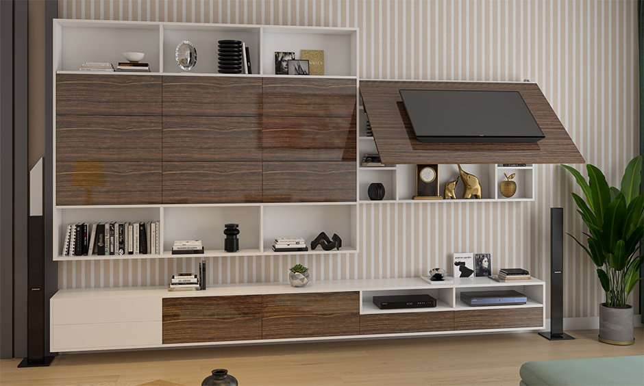 A wall-mounted tv unit with a mixture of open and closed cabinets is the best space-saving living room furniture.