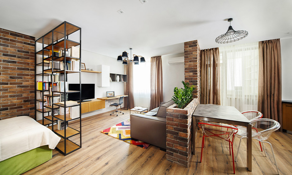 A room partition with open shelf space multi-purpose furniture design creating an airy interior design for the area.