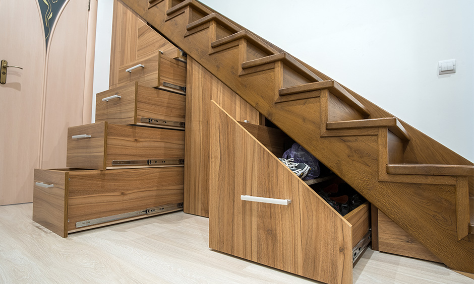 Multipurpose furniture wooden staircase with a hidden storage design for the small home creates extra storage.