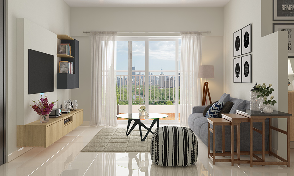 Designer living room furniture, the minimal living room has a three-tiered designer side table and glass centre table.