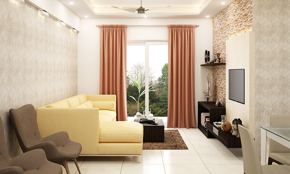 L-shaped designer sofa for living room in light yellow colour lends a refreshing vibe.