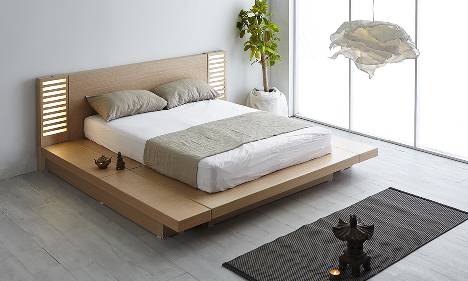 Bedroom in minimalist zen interior design with a low bed with an LED-lit headboard looks clean and clutter-free.