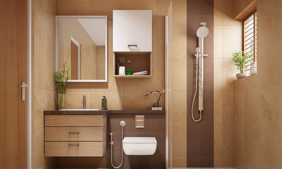 Bathroom in zen concept interior design with wooden vanity drawer and earth colour wall tiles gives an earthy look.