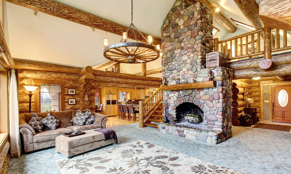 The rustic living room has a chandelier in a wheel shape, the best chandelier design for the living room.