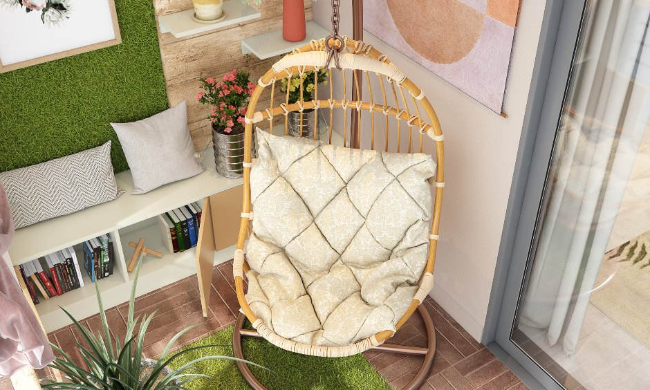 Balcony design with a single seater wicker swing and cushion