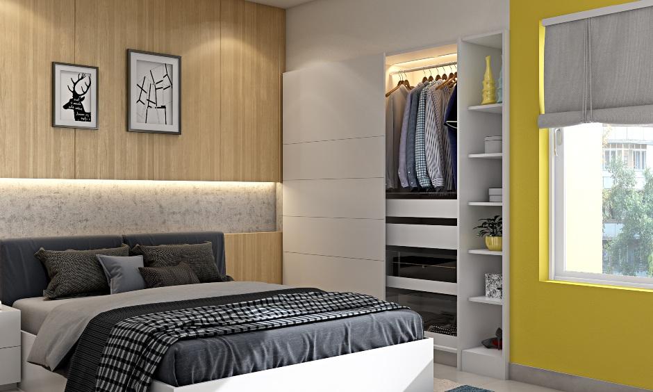Modern 2bhk bedroom with wardrobe with sliding door and mirror with hidden storage unit