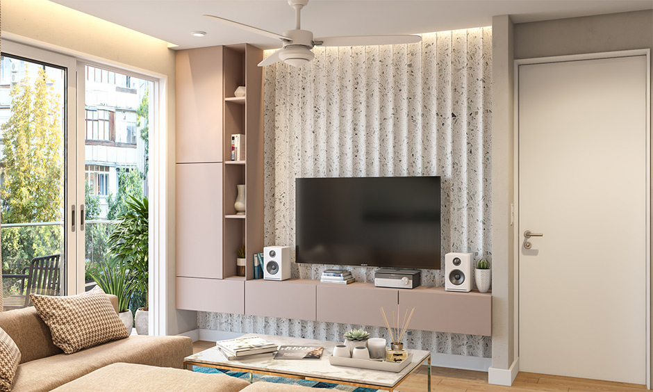 Modular wall mounted tv cabinet in pink laminate with open shelves lends an elegant look.