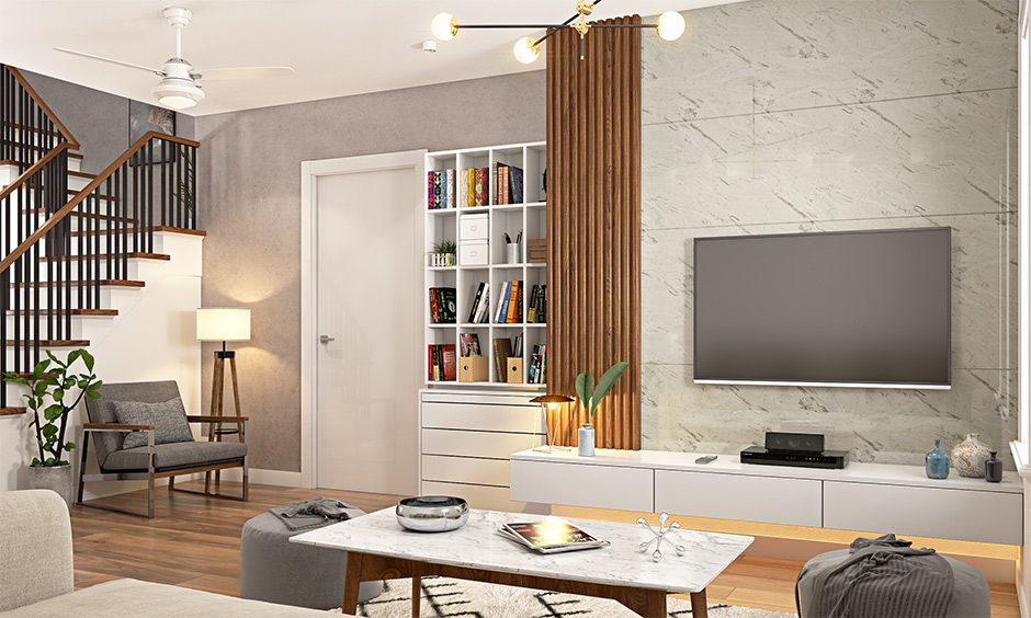 The living room has a tv cabinet design wall mounted with an attached bookshelf in white laminate.