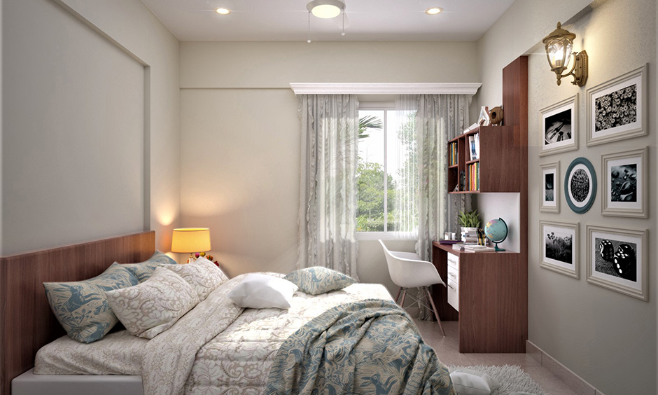 A bedroom decorated with accent lighting and photo frames on the wall is perfect elegant home decor.