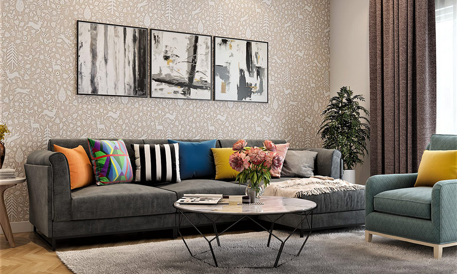Elegant home decor for the living room decorated with sectional sofa, wall art and the centre coffee table looks chic.