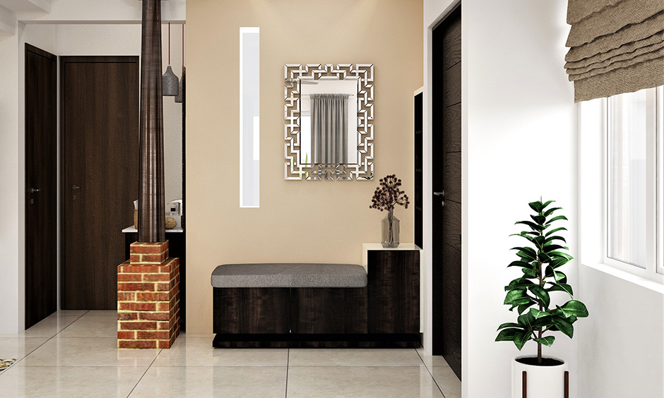 The foyer area elegant home decorated with a mirror and a small cushioned seating area beside the door looks gorgeous.