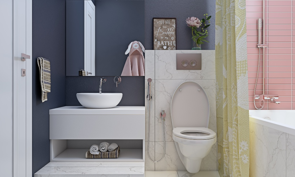 3 bhk home bathroom in grey, white and pink combination