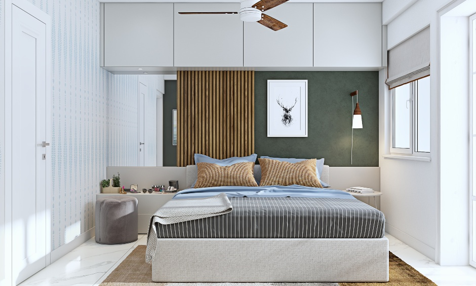 bedroom with dressing unit next to bed design for 3 bhk home interiors in mumbai