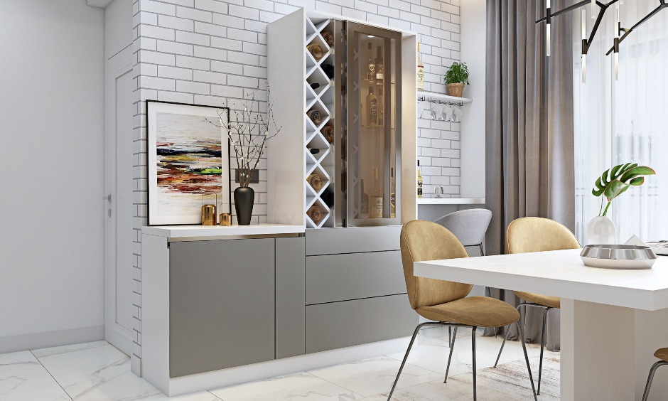 Dining room with bar unit designed with sliding door in 3 bhk flat interior design in india