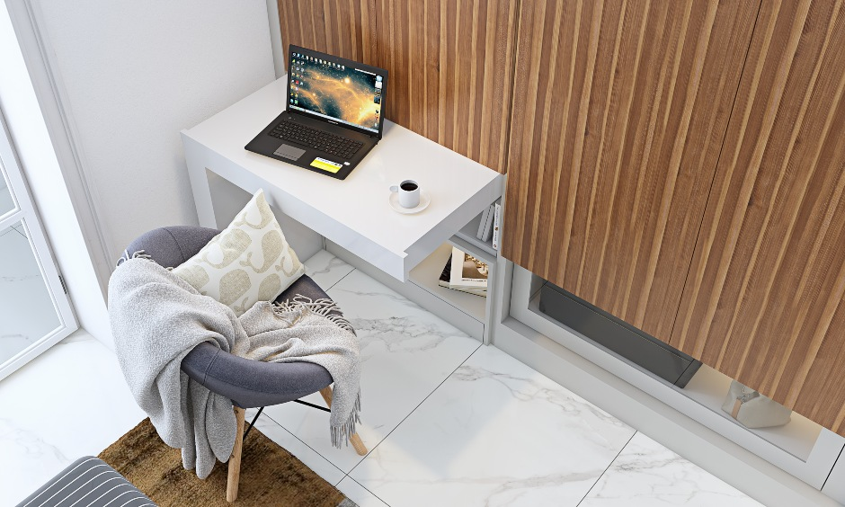 bedroom with pull out study table attached to wardrobe in 3 bhk home