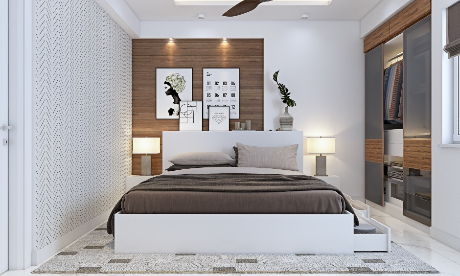 White bedroom with built-in wall wardrobe in 3 bhk flat interior design in bangalore