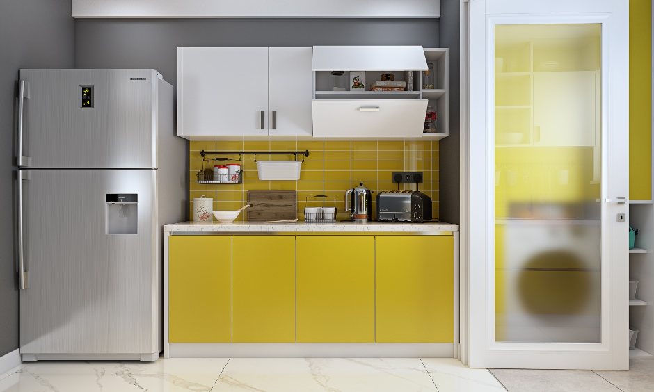 Parallel kitchen in yellow and white combination with crockery unit design for 3 bhk flat in hyderbad, mumbai and bengaluru