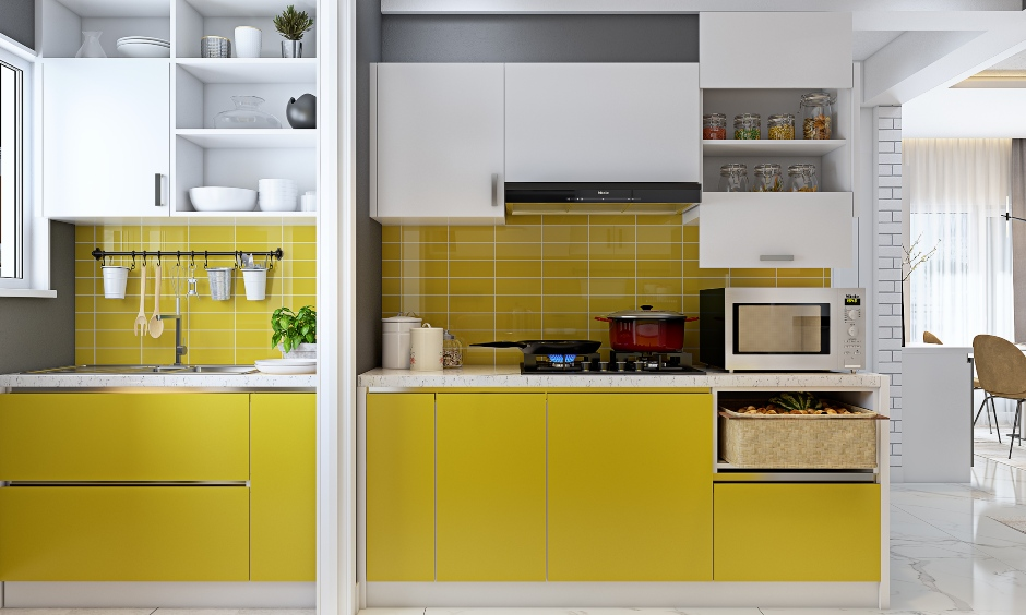 Parallel kitchen in yellow and white combination in 3 bhk home designed in india