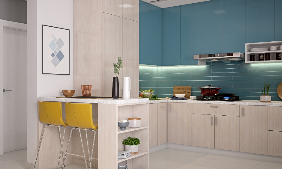 Blue and cream kitchen 3 bhk design home with breakfast counter and two tall chairs