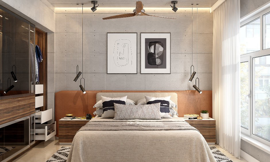 1 bhk flat bedroom designed with a bed, modular sliding wardrobe and wooden flooring