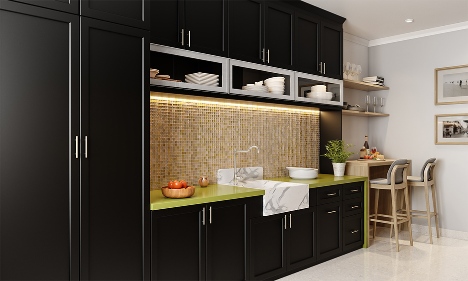 Straight modular kitchen designs  with cabinets painted in black, the beige mosaic tiled backsplash