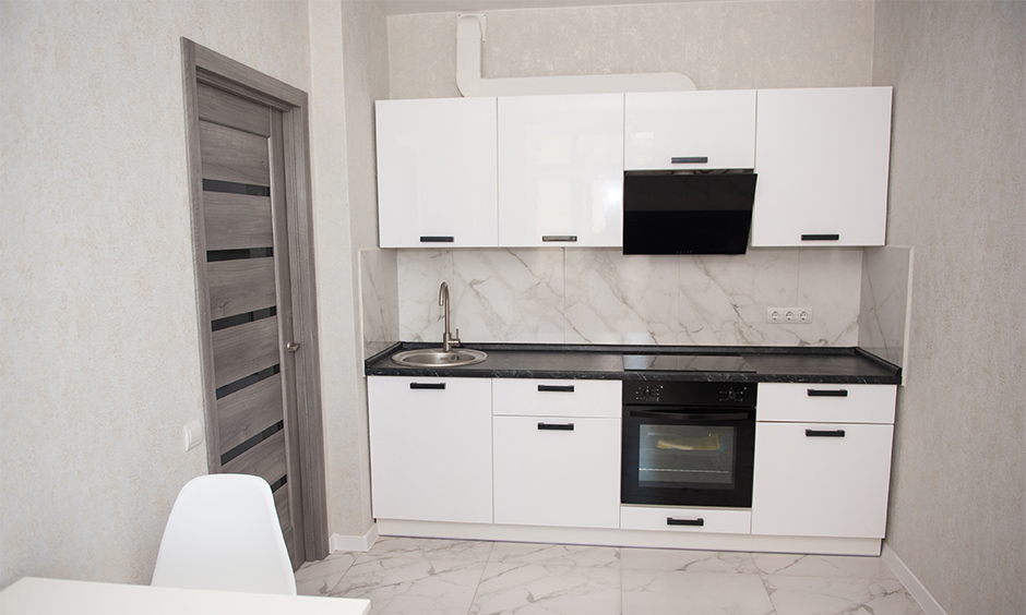 The ultra small straight line kitchen design studio apartment with enough storage space to hold crockery, utensils for small family