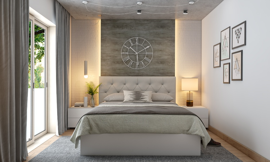 Bedroom colour design in neutral with accent wall behind the bed is flanked with a drop-down pendant light