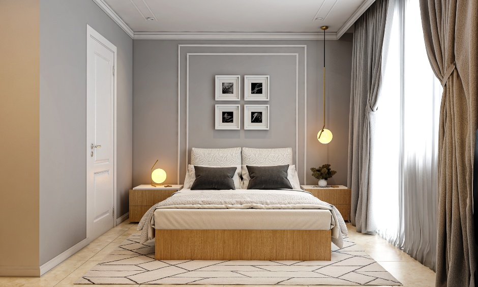Neoclassical bedroom design with wall moulding and pendant light on one side paired with a table lamp