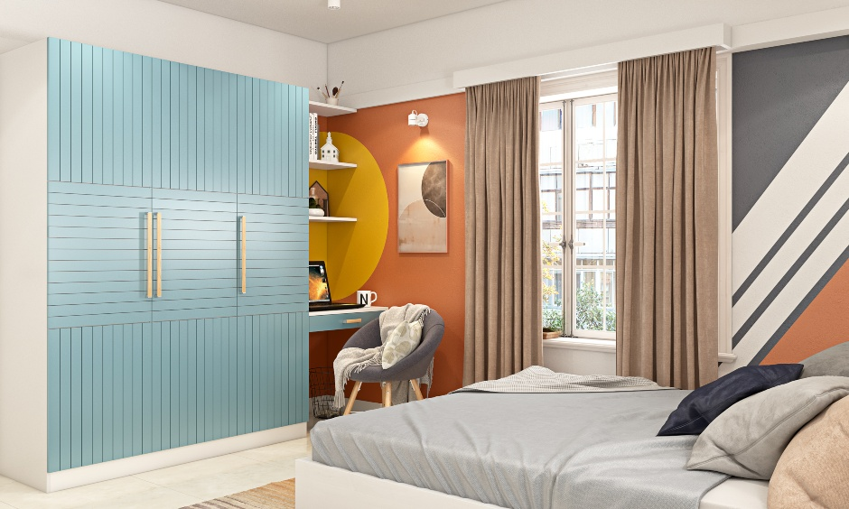 Bedroom wardrobe design where the sky-blue laminate on the door add vibrance to this bedroom's interiors