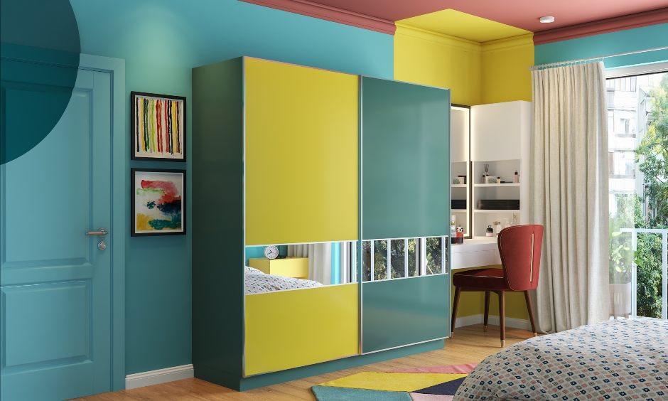 Modular wardrobe design where the drawers, overhead storage and shelves help in compact and neat organisation