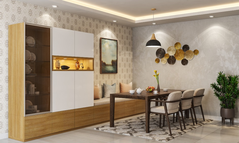 This dining room interior design is for people with small homes with walnut wood dining table and chairs and a glass front crockery unit