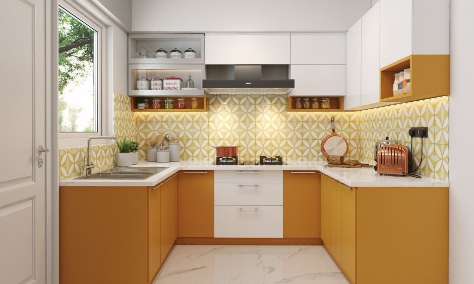 2bhk kitchen designed with pull-out units, drawers, cabinets and shelves for a clutter-free experience