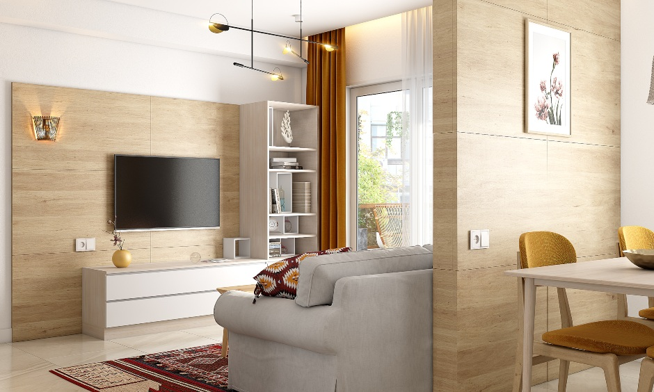 Living room in 2bhk interior designed in wood and white oozes a Scandinavian vibe